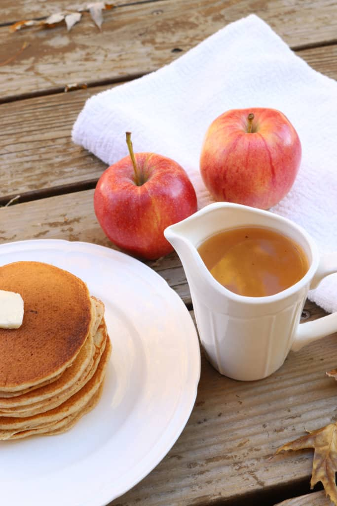 The best homemade apple syrup! This takes less than 5 minutes to make and uses ingredients you already have on hand. Paired with homemade whole wheat pancakes, and this makes a delicious meal. It's a great way to use up leftover apple juice! This would also make great neighbor Christmas gifts or gifts year round.
