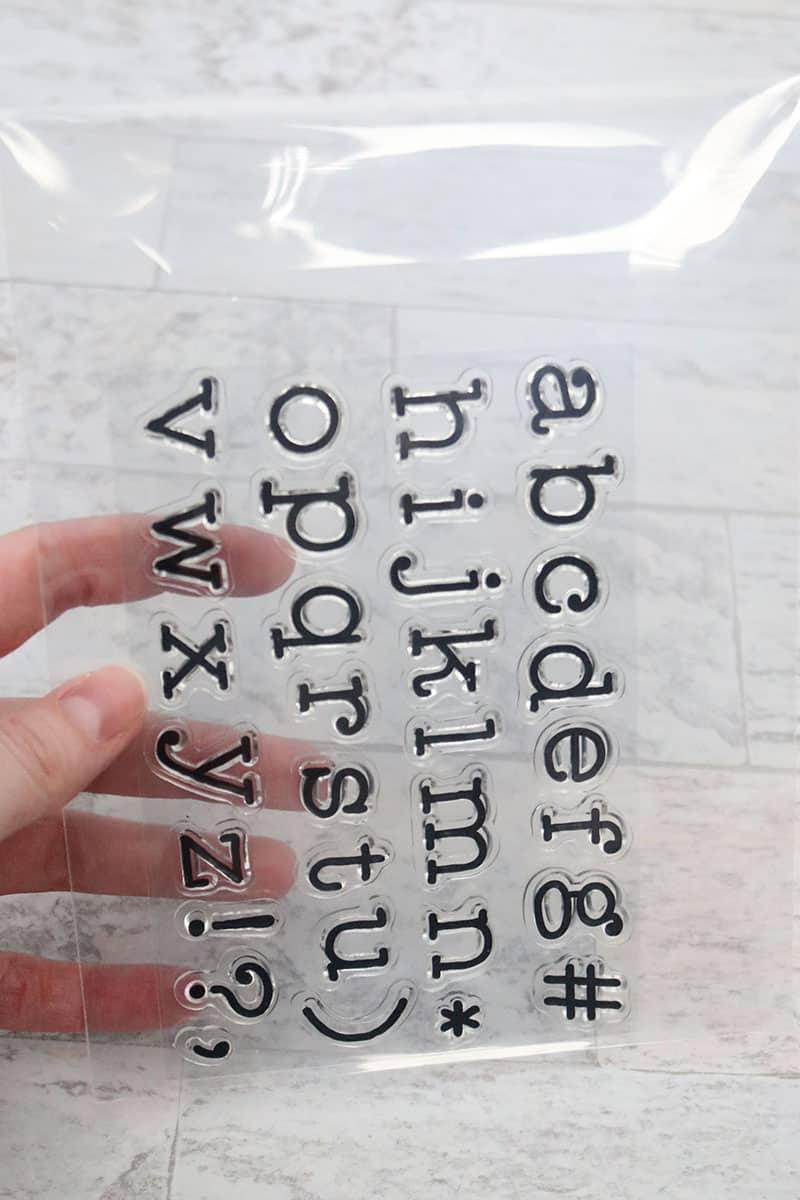 clear alphabet stamp set in clear storage pocket