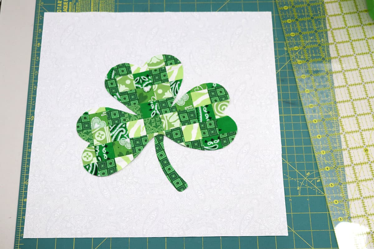 pieced shamrock on white background fabric
