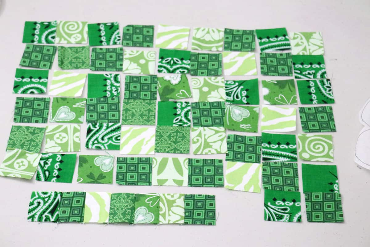 small green fabric squares on table