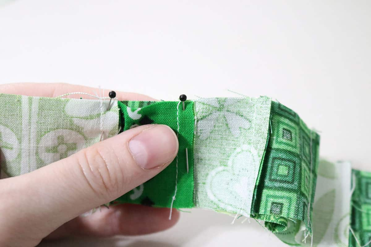 matching up seams on green fabric