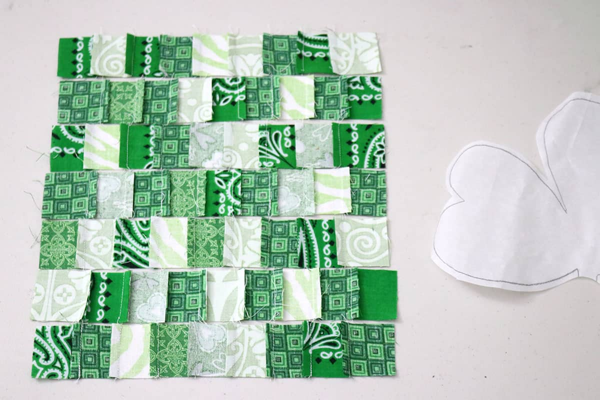 green fabric pieced in rows on table