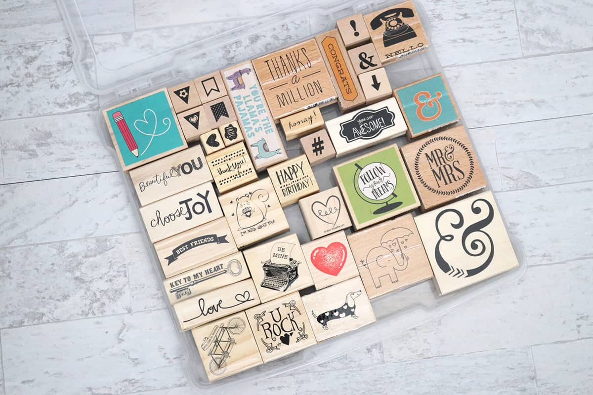 rubber stamps in clear storage container