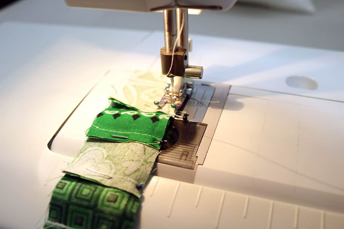 sewing green squares with sewing machine