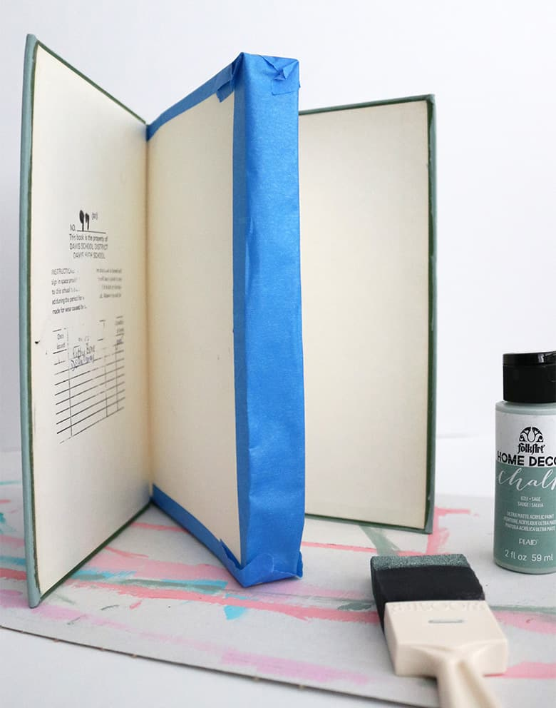 Looking for unique and cheap decor for a table or bookshelf? These chalk-painted and stamped books with custom sayings are so easy to DIY!