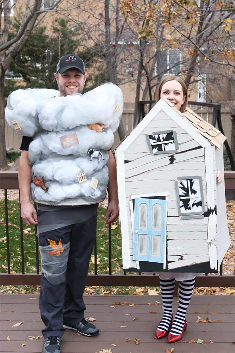 These Wizard of Oz Halloween costumes aren't the typical ones you see over and over! Learn how to make this Wicked Witch of the East and tornado couples costumes--from a box and a laundry hamper! A fun Halloween DIY.