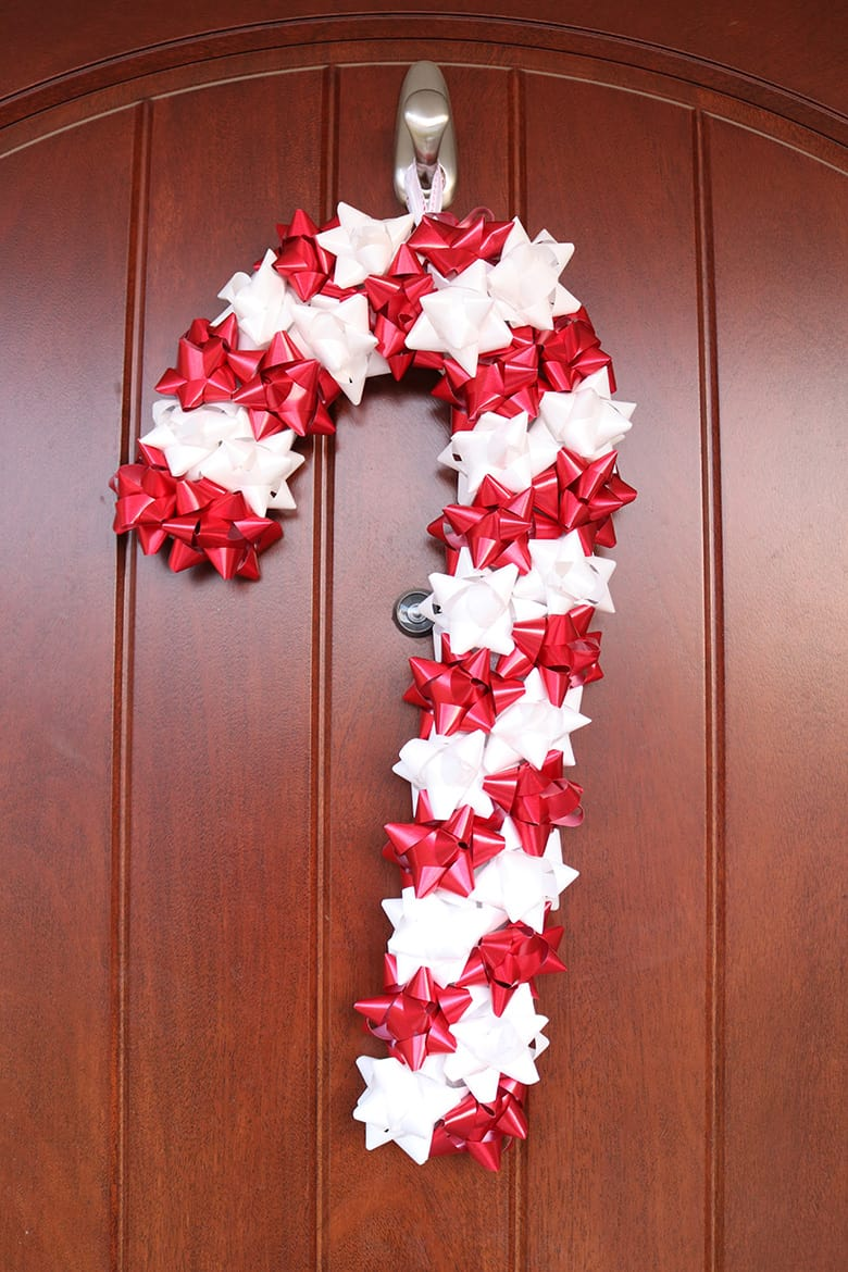 candy cane wreath made with stick-on Christmas bows